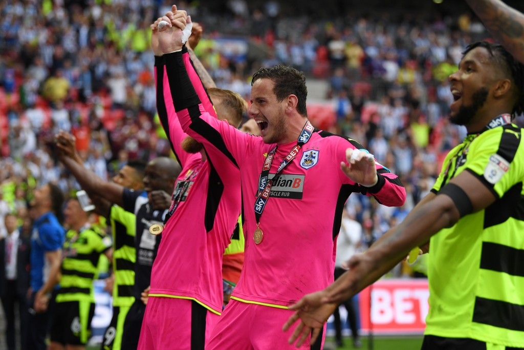 LONDON, ENGLAND - MAY 29: Danny Ward of Huddersfield Town celebrates promotion to the Premier League with his Huddersield Town team mates after the Sky Bet Championship play off final between Huddersfield and Reading at Wembley Stadium on May 29, 2017 in London, England. (Photo by Gareth Copley/Getty Images)