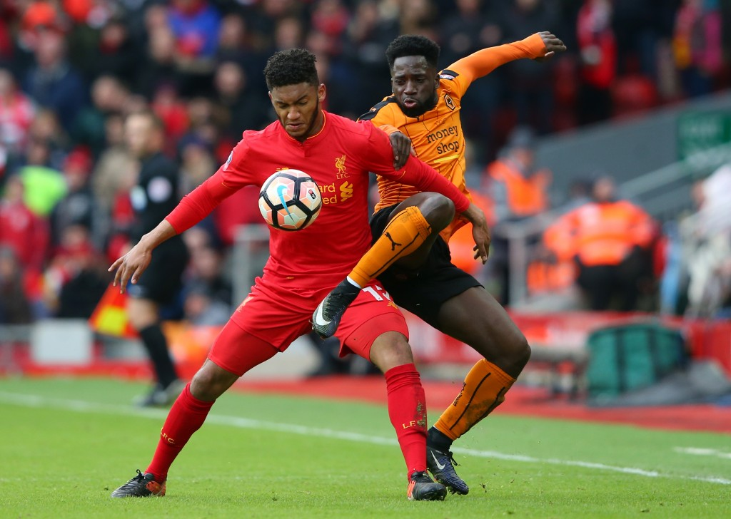 LIVERPOOL, ENGLAND - JANUARY 28: Joe Gomez of Liverpool and Nouha Dicko of Wolverhampton Wanderers compete for the ball during the Emirates FA Cup Fourth Round match between Liverpool and Wolverhampton Wanderers at Anfield on January 28, 2017 in Liverpool, England. (Photo by Alex Livesey/Getty Images)