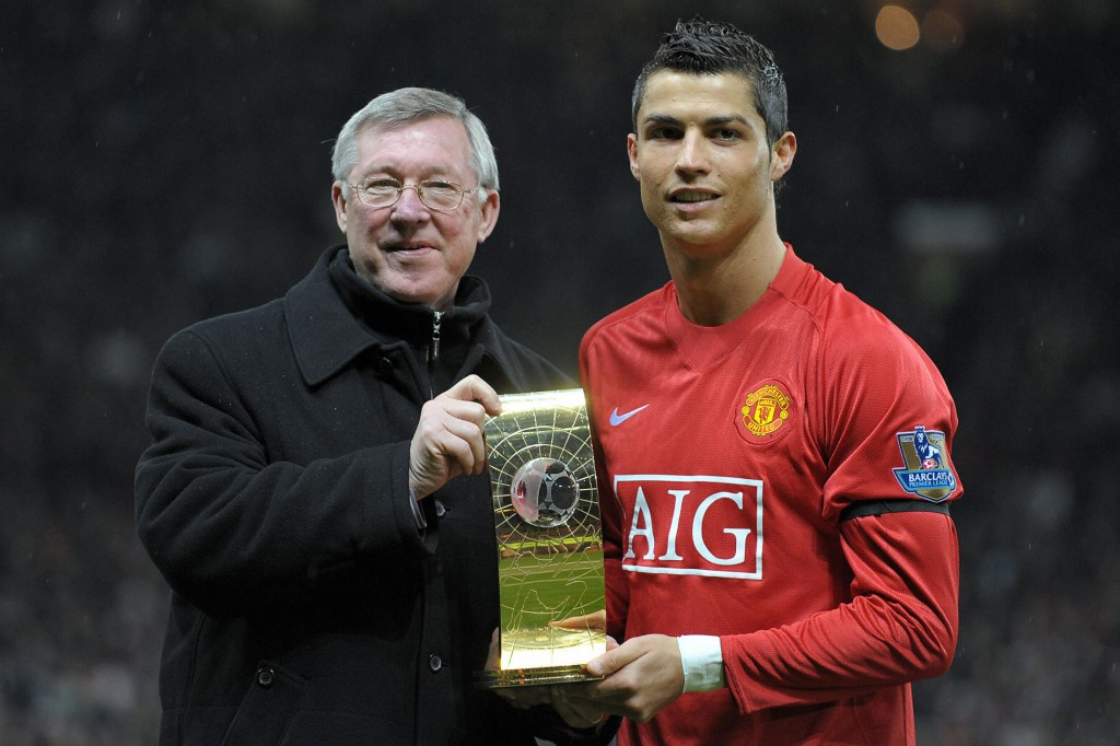 Manchester United's Portuguese midfielder Cristiano Ronaldo (R) poses with his FIFA world player of the year trophy with Manager Alex Ferguson before the English Premiership football match against Wigan at Old Trafford, Manchester, north-west England, on January 14, 2009. AFP PHOTO/ ANDREW YATES FOR EDITORIAL USE ONLY Additional licence required for any commercial/promotional use or use on TV or internet (except identical online version of newspaper) of Premier League/Football League photos. Tel DataCo +44 207 2981656. Do not alter/modify photo. (Photo credit should read ANDREW YATES/AFP/Getty Images)