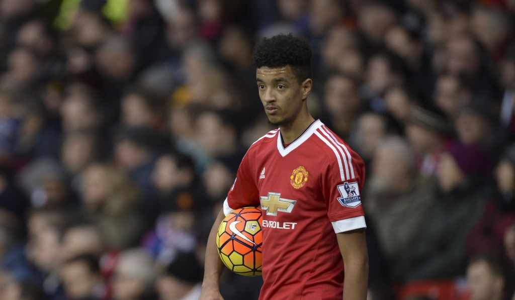 Manchester United's English defender Cameron Borthwick-Jackson prepares to take a throw in during the English Premier League football match between Manchester United and Southampton at Old Trafford in Manchester, north west England, on January 23, 2016. AFP PHOTO / OLI SCARFF RESTRICTED TO EDITORIAL USE. No use with unauthorized audio, video, data, fixture lists, club/league logos or 'live' services. Online in-match use limited to 75 images, no video emulation. No use in betting, games or single club/league/player publications. / AFP / OLI SCARFF (Photo credit should read OLI SCARFF/AFP/Getty Images)