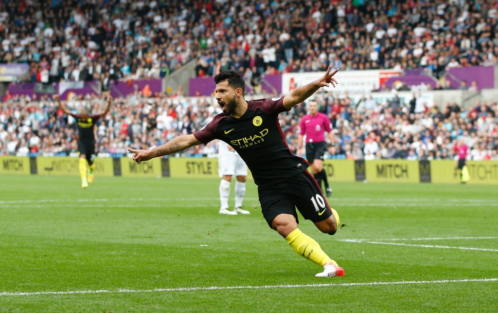 Manchester City's Argentinian striker Sergio Aguero celebrates scoring the opening goal during the English Premier League football match between Swansea City and Manchester City at The Liberty Stadium in Swansea, south Wales on September 24, 2016. / AFP / Adrian DENNIS / RESTRICTED TO EDITORIAL USE. No use with unauthorized audio, video, data, fixture lists, club/league logos or 'live' services. Online in-match use limited to 75 images, no video emulation. No use in betting, games or single club/league/player publications. / (Photo credit should read ADRIAN DENNIS/AFP/Getty Images)
