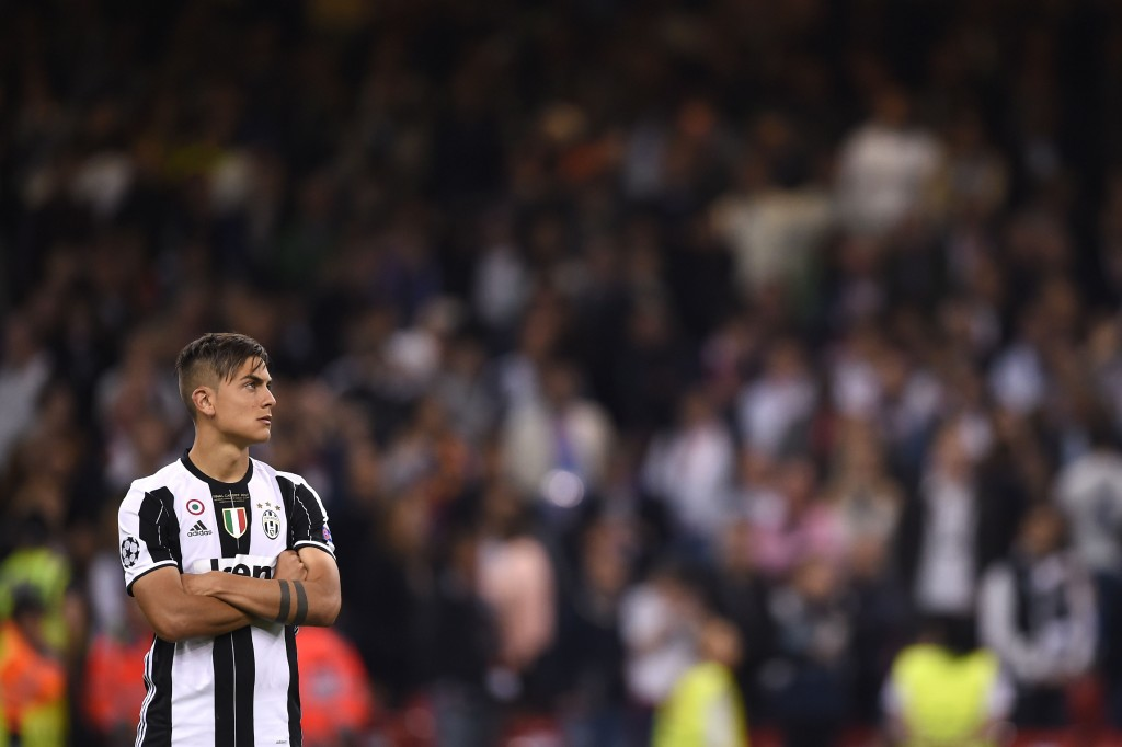 Juventus' Argentinian striker Paulo Dybala reacts after losing the UEFA Champions League final football match between Juventus and Real Madrid at The Principality Stadium in Cardiff, south Wales, on June 3, 2017. / AFP PHOTO / Filippo MONTEFORTE (Photo credit should read FILIPPO MONTEFORTE/AFP/Getty Images)
