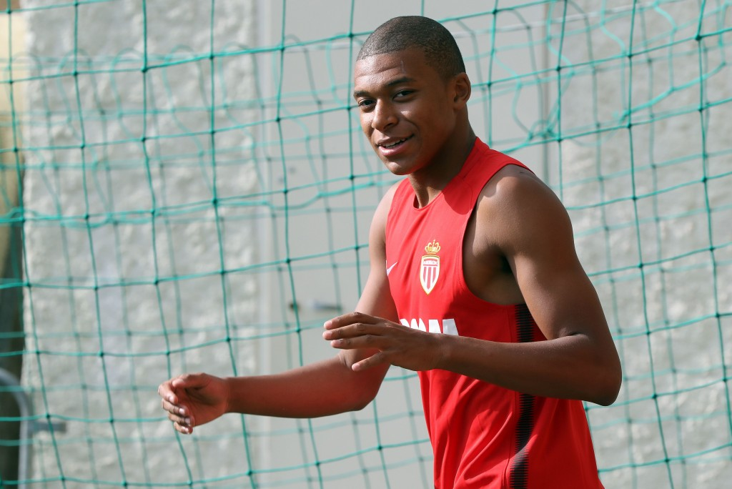 Monaco's French forward Kylian Mbappe arrives for a training session in La Turbie near Monaco on July 10, 2017. / AFP PHOTO / VALERY HACHE (Photo credit should read VALERY HACHE/AFP/Getty Images)