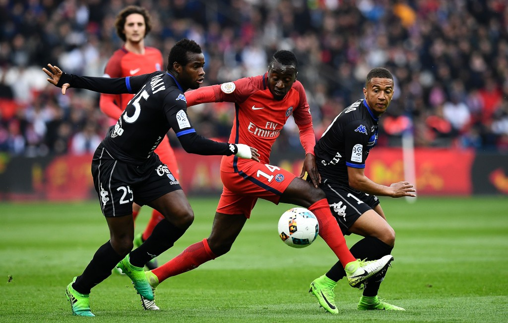 Paris Saint-Germain's French midfielder Blaise Matuidi (C) challenges Bastia's Malian midfielder Lassana Coulibaly (L) and Bastia's French midfielder Axel Ngando during the French L1 football match between Paris Saint-Germain and Bastia at the Parc des Princes stadium in Paris on May 6, 2017. / AFP PHOTO / FRANCK FIFE (Photo credit should read FRANCK FIFE/AFP/Getty Images)