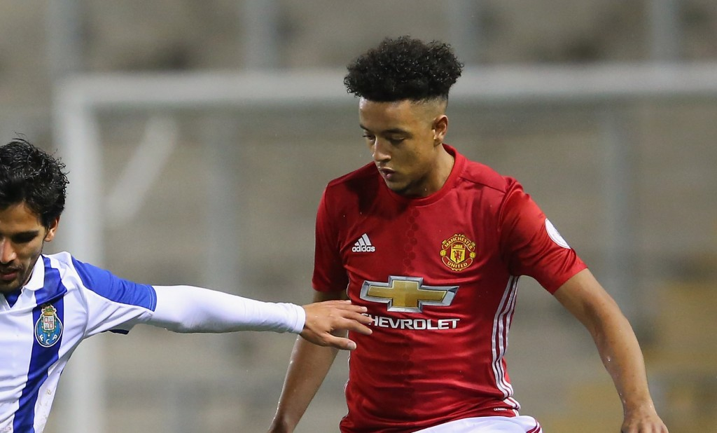 LEIGH, GREATER MANCHESTER - FEBRUARY 22: Joao Graca of Porto holds off a challenge from Regan Poole and Cameron Borthwick-Jackson of Manchester United during the Premier League International Cup Quarter Final match between Manchester United U23 and Porto B at Leigh Sports Village on February 22, 2017 in Leigh, Greater Manchester. (Photo by Alex Livesey/Getty Images)