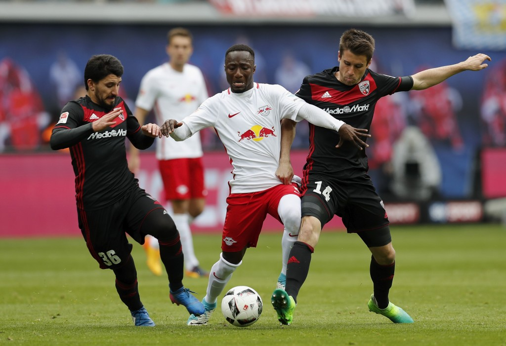 LEIPZIG, GERMANY - APRIL 29: Naby Keita of RB Leipzig is challenged by Almog Cohen and Stefan Lex of FC Ingolstadt 04 during the Bundesliga match between RB Leipzig and FC Ingolstadt 04 at Red Bull Arena on April 29, 2017 in Leipzig, Germany. (Photo by Boris Streubel/Bongarts/Getty Images)