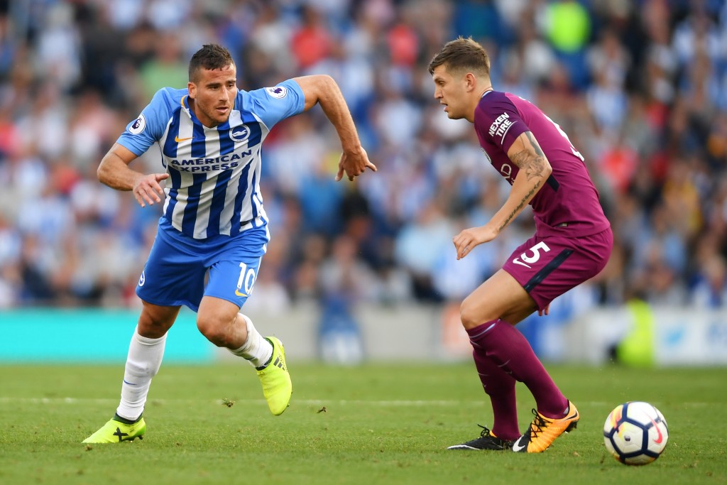 BRIGHTON, ENGLAND - AUGUST 12: Tomer Hemed of Brighton and Hove Albion attempts to get past John Stones of Manchester City during the Premier League match between Brighton and Hove Albion and Manchester City at the Amex Stadium on August 12, 2017 in Brighton, England. (Photo by Mike Hewitt/Getty Images)