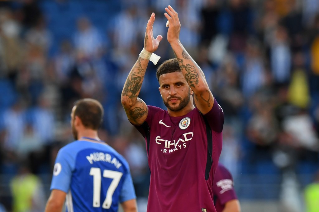 Manchester City's English defender Kyle Walker applauds supporters after the English Premier League football match between Brighton and Hove Albion and Manchester City at the American Express Community Stadium in Brighton, southern England on August 12, 2017. Manchester City won the game 2-0. / AFP PHOTO / CHRIS J RATCLIFFE / RESTRICTED TO EDITORIAL USE. No use with unauthorized audio, video, data, fixture lists, club/league logos or 'live' services. Online in-match use limited to 75 images, no video emulation. No use in betting, games or single club/league/player publications. / (Photo credit should read CHRIS J RATCLIFFE/AFP/Getty Images)