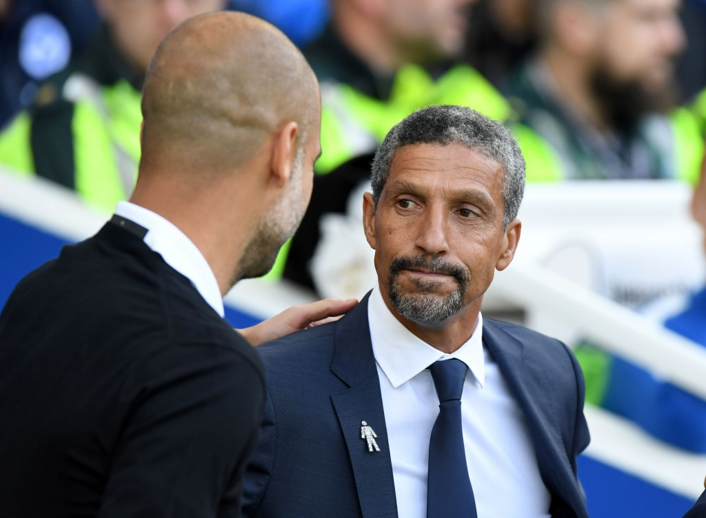 Brighton's Irish manager Chris Hughton (R) greets Manchester City's Spanish manager Pep Guardiola ahead of the English Premier League football match between Brighton and Hove Albion and Manchester City at the American Express Community Stadium in Brighton, southern England on August 12, 2017. / AFP PHOTO / CHRIS J RATCLIFFE / RESTRICTED TO EDITORIAL USE. No use with unauthorized audio, video, data, fixture lists, club/league logos or 'live' services. Online in-match use limited to 75 images, no video emulation. No use in betting, games or single club/league/player publications. / (Photo credit should read CHRIS J RATCLIFFE/AFP/Getty Images)