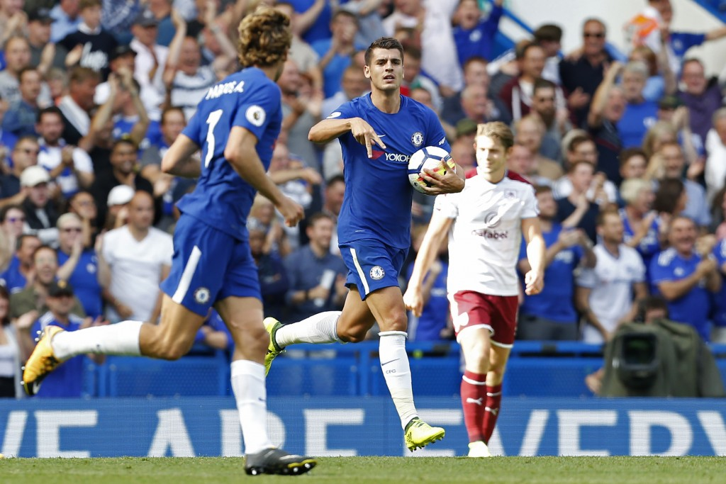 Chelsea's Spanish striker Alvaro Morata (C) celebrates scoring his first Premier League goal during the English Premier League football match between Chelsea and Burnley at Stamford Bridge in London on August 12, 2017. / AFP PHOTO / Ian KINGTON / RESTRICTED TO EDITORIAL USE. No use with unauthorized audio, video, data, fixture lists, club/league logos or 'live' services. Online in-match use limited to 75 images, no video emulation. No use in betting, games or single club/league/player publications. / (Photo credit should read IAN KINGTON/AFP/Getty Images)