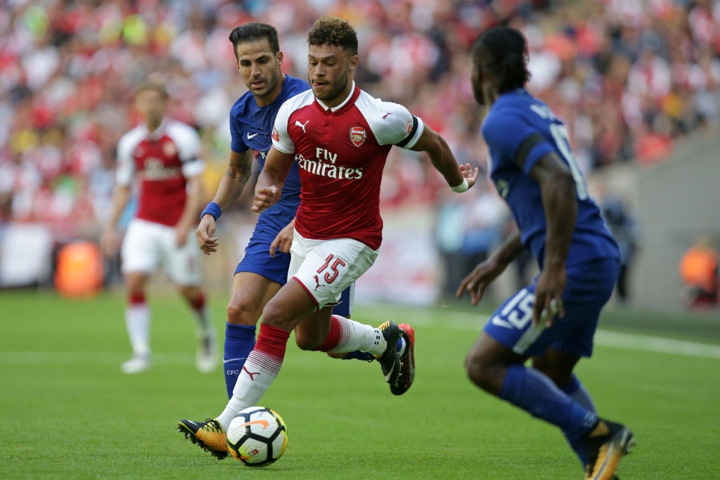 Arsenal's English midfielder Alex Oxlade-Chamberlain vies with Chelsea's Spanish midfielder Cesc Fabregas (L) during the English FA Community Shield football match between Arsenal and Chelsea at Wembley Stadium in north London on August 6, 2017. / AFP PHOTO / Daniel LEAL-OLIVAS / NOT FOR MARKETING OR ADVERTISING USE / RESTRICTED TO EDITORIAL USE (Photo credit should read DANIEL LEAL-OLIVAS/AFP/Getty Images)