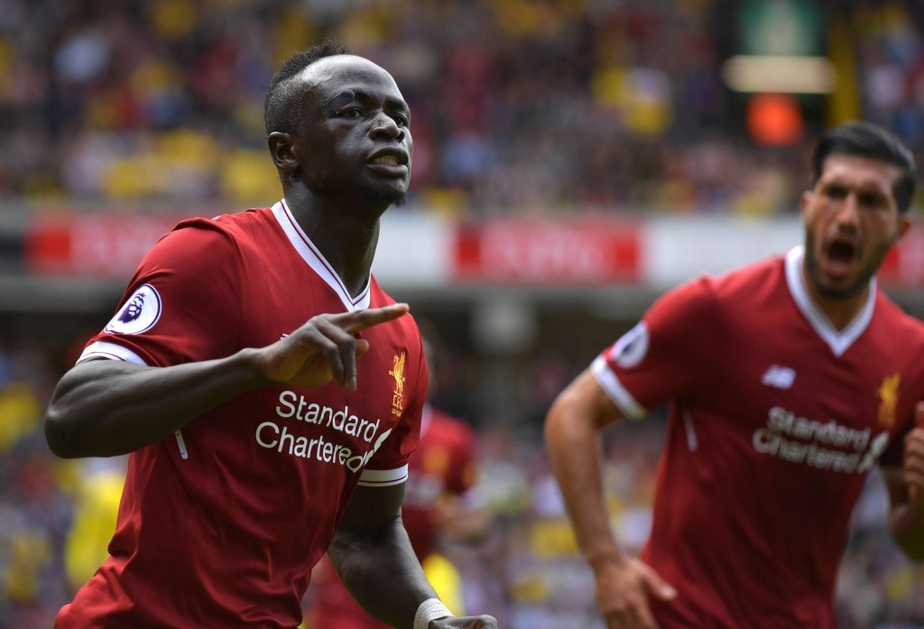 Liverpool's Senegalese midfielder Sadio Mane (l) celebrates scoring his team's second goal during the English Premier League football match between Watford and Liverpool at Vicarage Road Stadium in Watford, north of London on August 12, 2017. / AFP PHOTO / OLLY GREENWOOD / RESTRICTED TO EDITORIAL USE. No use with unauthorized audio, video, data, fixture lists, club/league logos or 'live' services. Online in-match use limited to 75 images, no video emulation. No use in betting, games or single club/league/player publications. / (Photo credit should read OLLY GREENWOOD/AFP/Getty Images)