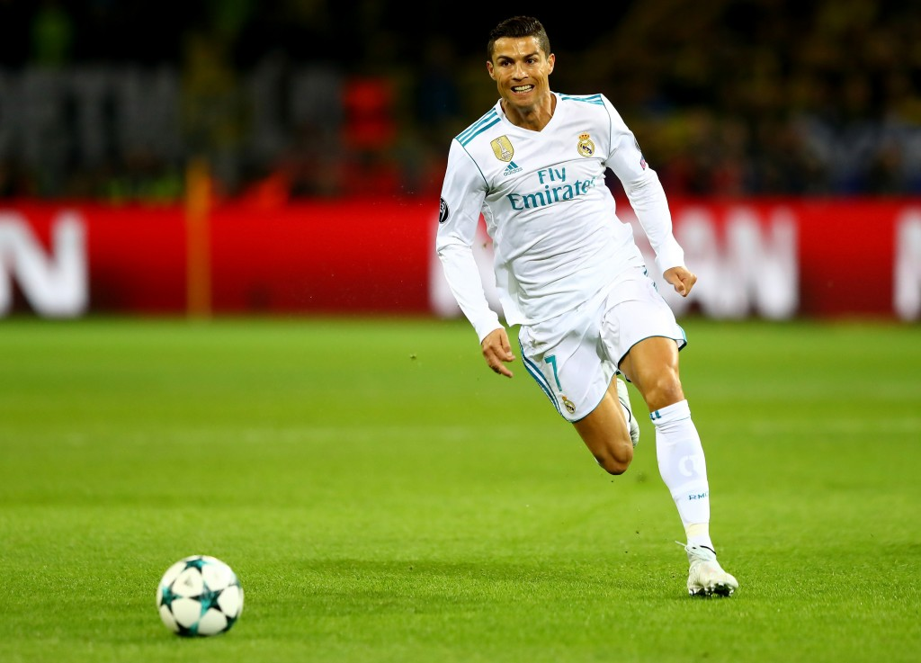DORTMUND, GERMANY - SEPTEMBER 26: Cristiano Ronaldo of Real Madrid runs with the ball during the UEFA Champions League group H match between Borussia Dortmund and Real Madrid at Signal Iduna Park on September 26, 2017 in Dortmund, Germany. (Photo by Martin Rose/Bongarts/Getty Images)
