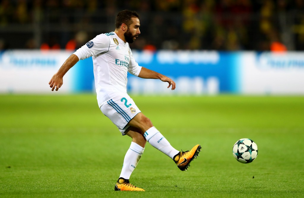 DORTMUND, GERMANY - SEPTEMBER 26: Dani Carvajal of Real Madrid runs with the ball during the UEFA Champions League group H match between Borussia Dortmund and Real Madrid at Signal Iduna Park on September 26, 2017 in Dortmund, Germany. (Photo by Martin Rose/Bongarts/Getty Images)