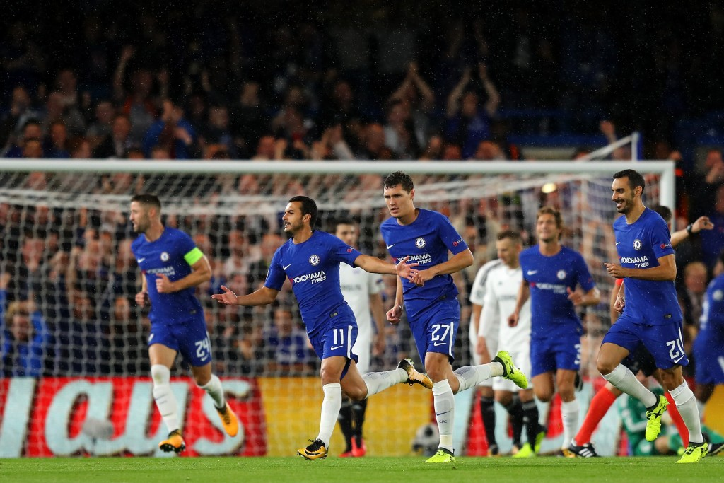 LONDON, ENGLAND - SEPTEMBER 12: Pedro of Chelsea celebrates scoring his sides first goal with his Chelsea team mates during the UEFA Champions League Group C match between Chelsea FC and Qarabag FK at Stamford Bridge on September 12, 2017 in London, United Kingdom. (Photo by Richard Heathcote/Getty Images)