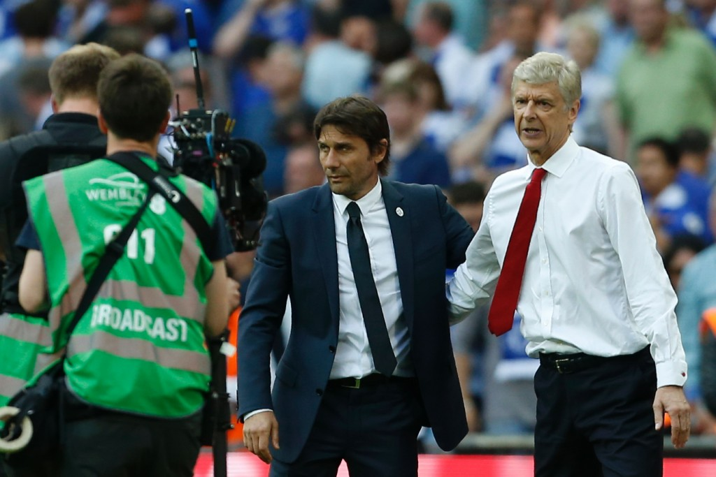 Two great managers with different battles to fight. (Picture Courtesy - AFP/Getty Images)