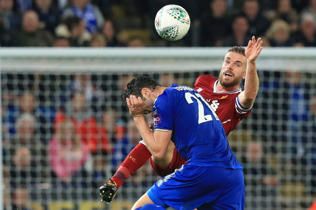 Leicester City's Spanish midfielder Vicente Iborra (L) vies with Liverpool's English midfielder Jordan Henderson (R) during the English League Cup third round football match between Leicester City and Liverpool at King Power Stadium in Leicester, central England on September 19, 2017. / AFP PHOTO / Lindsey PARNABY / RESTRICTED TO EDITORIAL USE. No use with unauthorized audio, video, data, fixture lists, club/league logos or 'live' services. Online in-match use limited to 75 images, no video emulation. No use in betting, games or single club/league/player publications. / (Photo credit should read LINDSEY PARNABY/AFP/Getty Images)