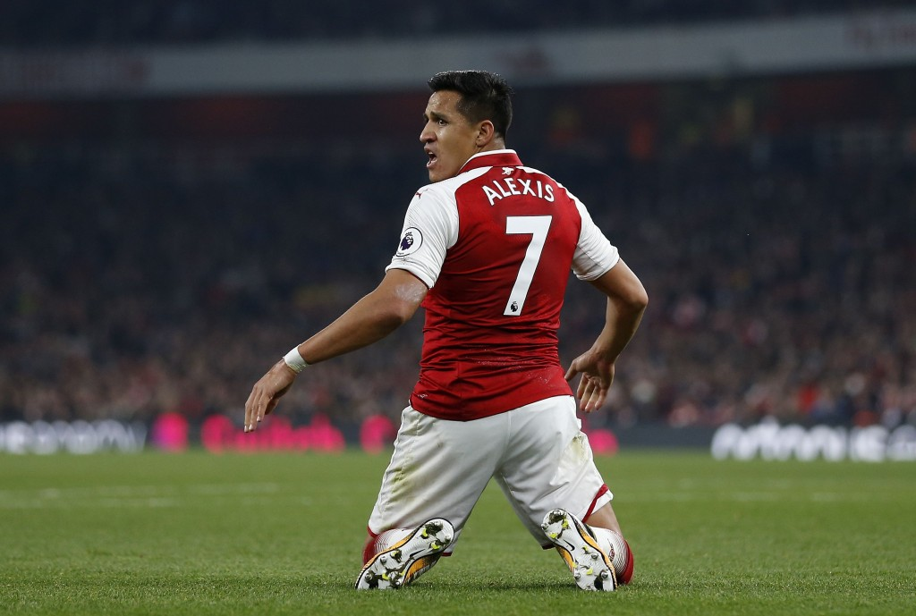 Arsenal's Chilean striker Alexis Sanchez reacts during the English Premier League football match between Arsenal and West Bromwich Albion at the Emirates Stadium in London on September 25, 2017. / AFP PHOTO / Ian KINGTON / RESTRICTED TO EDITORIAL USE. No use with unauthorized audio, video, data, fixture lists, club/league logos or 'live' services. Online in-match use limited to 75 images, no video emulation. No use in betting, games or single club/league/player publications. / (Photo credit should read IAN KINGTON/AFP/Getty Images)