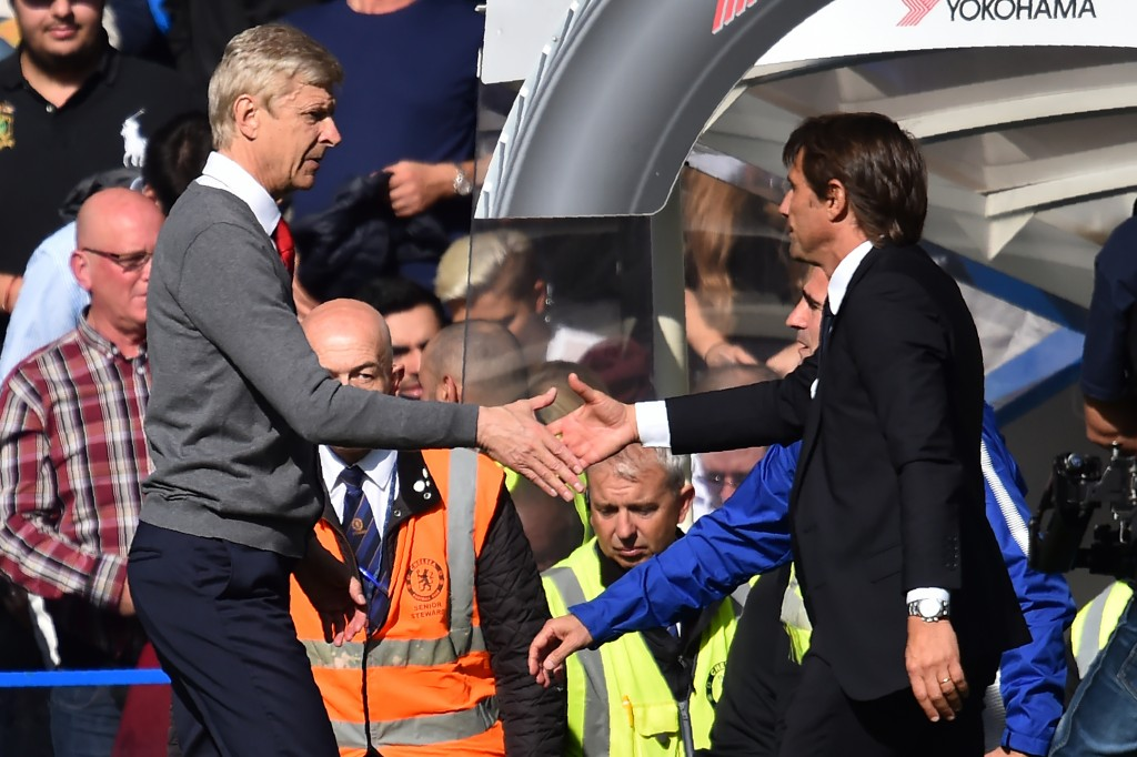Chelsea's Italian head coach Antonio Conte (R) shakes hands with Arsenal's French manager Arsene Wenger (L) after the English Premier League football match between Chelsea and Arsenal at Stamford Bridge in London on September 17, 2017. The game ended 0-0. / AFP PHOTO / Glyn KIRK / RESTRICTED TO EDITORIAL USE. No use with unauthorized audio, video, data, fixture lists, club/league logos or 'live' services. Online in-match use limited to 75 images, no video emulation. No use in betting, games or single club/league/player publications. / (Photo credit should read GLYN KIRK/AFP/Getty Images)