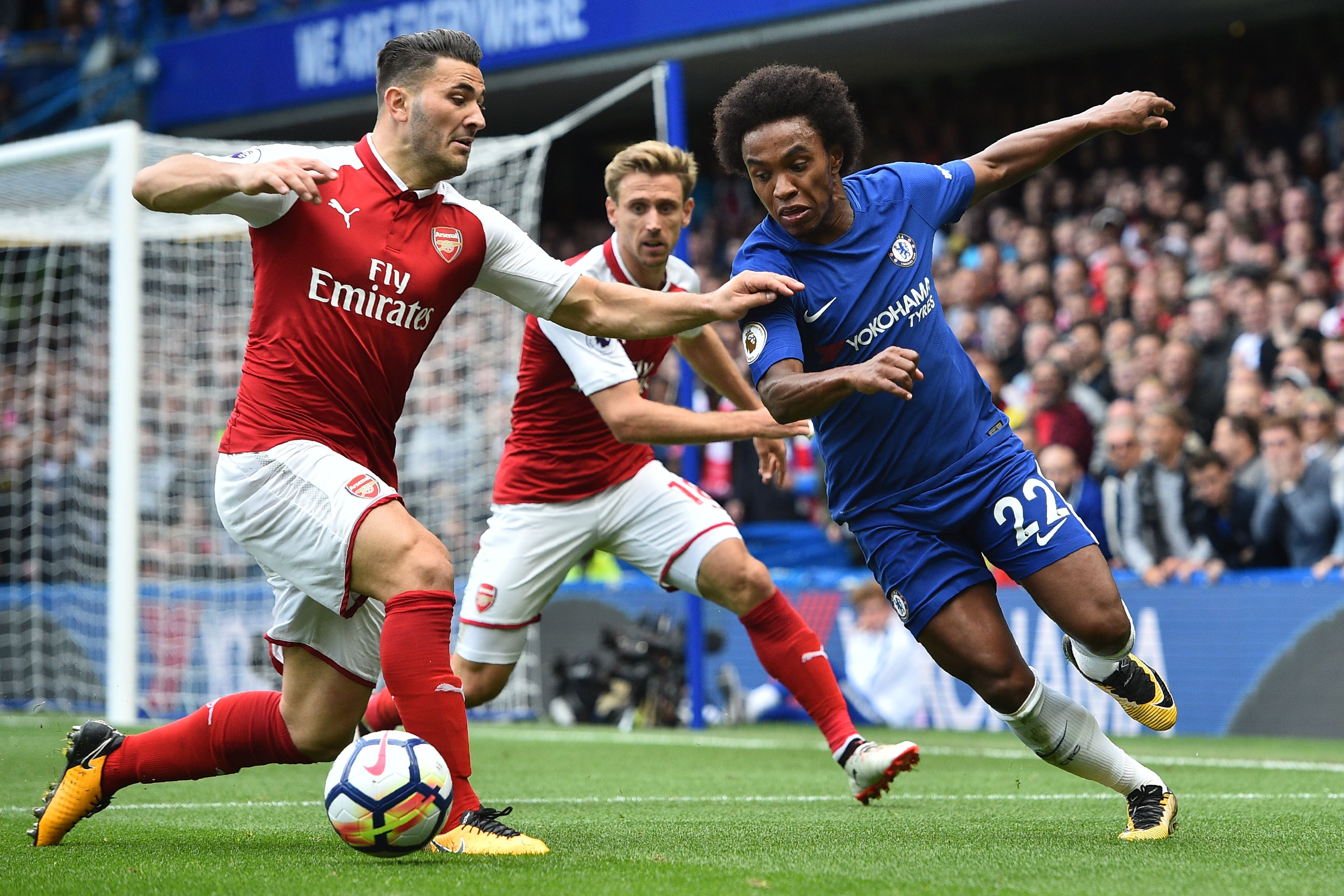Arsenal's German-born Bosnian defender Sead Kolasinac (L) vies with Chelsea's Brazilian midfielder Willian during the English Premier League football match between Chelsea and Arsenal at Stamford Bridge in London on September 17, 2017. / AFP PHOTO / Glyn KIRK / RESTRICTED TO EDITORIAL USE. No use with unauthorized audio, video, data, fixture lists, club/league logos or 'live' services. Online in-match use limited to 75 images, no video emulation. No use in betting, games or single club/league/player publications. / (Photo credit should read GLYN KIRK/AFP/Getty Images)