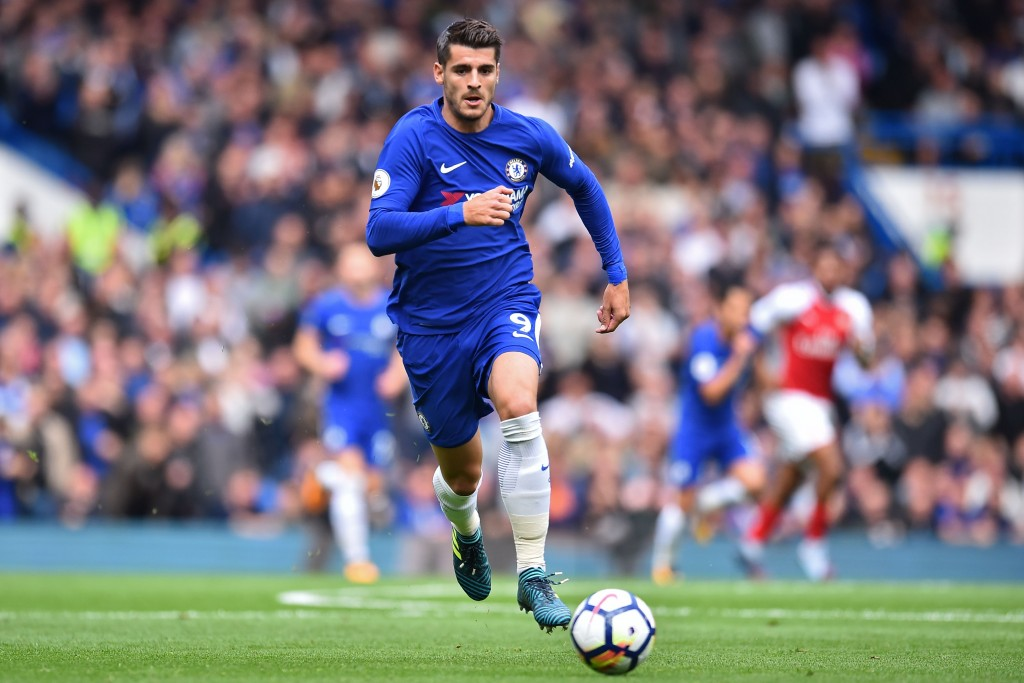 Chelsea's Spanish striker Alvaro Morata runs with the ball during the English Premier League football match between Chelsea and Arsenal at Stamford Bridge in London on September 17, 2017. / AFP PHOTO / Glyn KIRK / RESTRICTED TO EDITORIAL USE. No use with unauthorized audio, video, data, fixture lists, club/league logos or 'live' services. Online in-match use limited to 75 images, no video emulation. No use in betting, games or single club/league/player publications. / (Photo credit should read GLYN KIRK/AFP/Getty Images)