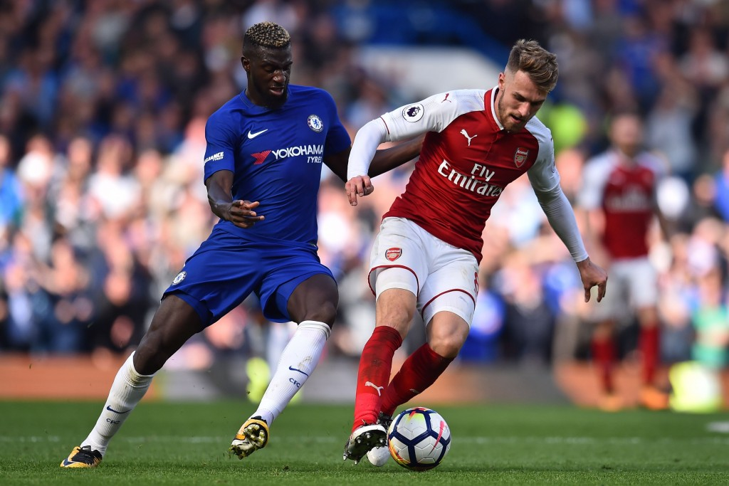 Arsenal's Welsh midfielder Aaron Ramsey (R) vies with Chelsea's French midfielder Tiemoue Bakayoko during the English Premier League football match between Chelsea and Arsenal at Stamford Bridge in London on September 17, 2017. / AFP PHOTO / Glyn KIRK / RESTRICTED TO EDITORIAL USE. No use with unauthorized audio, video, data, fixture lists, club/league logos or 'live' services. Online in-match use limited to 75 images, no video emulation. No use in betting, games or single club/league/player publications. / (Photo credit should read GLYN KIRK/AFP/Getty Images)