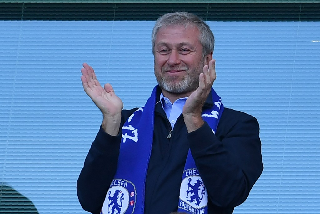 Chelsea's Russian owner Roman Abramovich applauds, as players celebrate their league title win at the end of the Premier League football match between Chelsea and Sunderland at Stamford Bridge in London on May 21, 2017. Chelsea's extended victory parade reached a climax with the trophy presentation on May 21, 2017 after being crowned Premier League champions with two games to go. / AFP PHOTO / Ben STANSALL / RESTRICTED TO EDITORIAL USE. No use with unauthorized audio, video, data, fixture lists, club/league logos or 'live' services. Online in-match use limited to 75 images, no video emulation. No use in betting, games or single club/league/player publications. / (Photo credit should read BEN STANSALL/AFP/Getty Images)