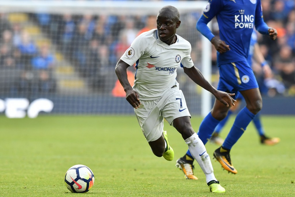 Chelsea's French midfielder N'Golo Kante runs with the ball during the English Premier League football match between Leicester City and Chelsea at King Power Stadium in Leicester, central England on September 9, 2017. Chelsea won the game 2-1. / AFP PHOTO / Ben STANSALL / RESTRICTED TO EDITORIAL USE. No use with unauthorized audio, video, data, fixture lists, club/league logos or 'live' services. Online in-match use limited to 75 images, no video emulation. No use in betting, games or single club/league/player publications. / (Photo credit should read BEN STANSALL/AFP/Getty Images)