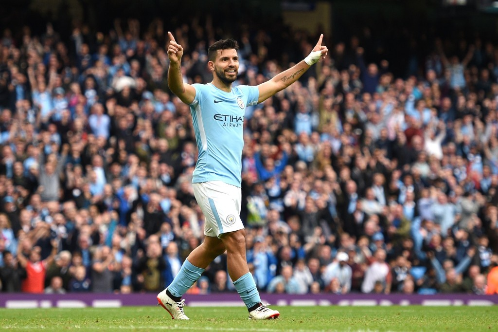Manchester City's Argentinian striker Sergio Aguero celebrates after scoring their fourth goal during the English Premier League football match between Manchester City and Crystal Palace at the Etihad Stadium in Manchester, north west England, on September 23, 2017. / AFP PHOTO / Oli SCARFF / RESTRICTED TO EDITORIAL USE. No use with unauthorized audio, video, data, fixture lists, club/league logos or 'live' services. Online in-match use limited to 75 images, no video emulation. No use in betting, games or single club/league/player publications. / (Photo credit should read OLI SCARFF/AFP/Getty Images)