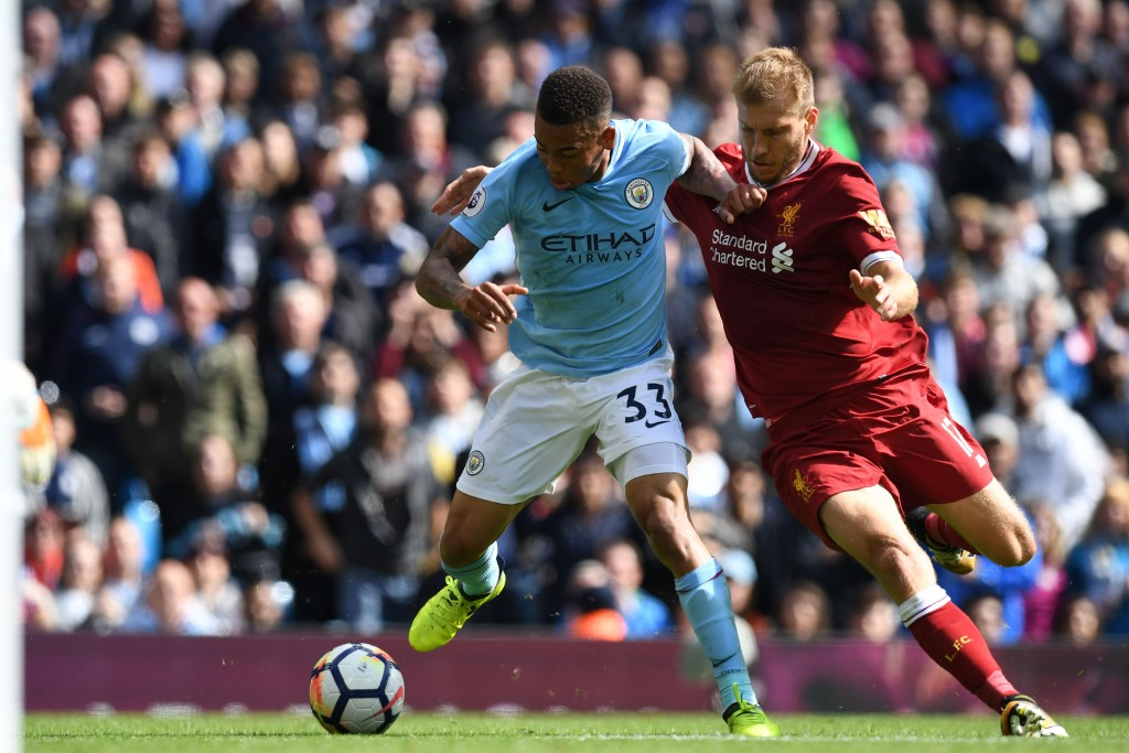 Manchester City's Brazilian striker Gabriel Jesus vies with Liverpool's Estonian defender Ragnar Klavan during the English Premier League football match between Manchester City and Liverpool at the Etihad Stadium in Manchester north west England