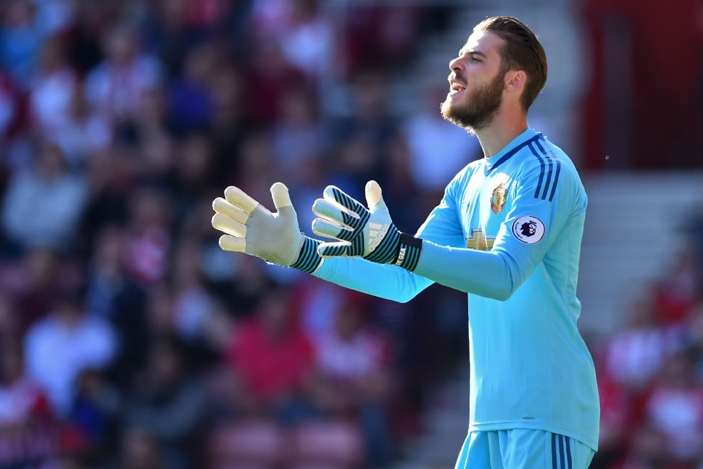 Manchester United's Spanish goalkeeper David de Gea gestures during the English Premier League football match between Southampton and Manchester United at St Mary's Stadium in Southampton, southern England on September 23, 2017. / AFP PHOTO / Glyn KIRK / RESTRICTED TO EDITORIAL USE. No use with unauthorized audio, video, data, fixture lists, club/league logos or 'live' services. Online in-match use limited to 75 images, no video emulation. No use in betting, games or single club/league/player publications. / (Photo credit should read GLYN KIRK/AFP/Getty Images)