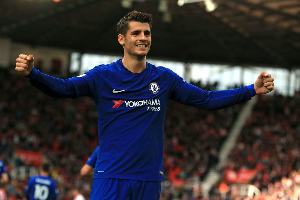 Chelsea's Spanish striker Alvaro Morata celebrates scoring their third goal during the English Premier League football match between Stoke City and Chelsea at the Bet365 Stadium in Stoke-on-Trent, central England on September 23, 2017. / AFP PHOTO / Lindsey PARNABY / RESTRICTED TO EDITORIAL USE. No use with unauthorized audio, video, data, fixture lists, club/league logos or 'live' services. Online in-match use limited to 75 images, no video emulation. No use in betting, games or single club/league/player publications. / (Photo credit should read LINDSEY PARNABY/AFP/Getty Images)