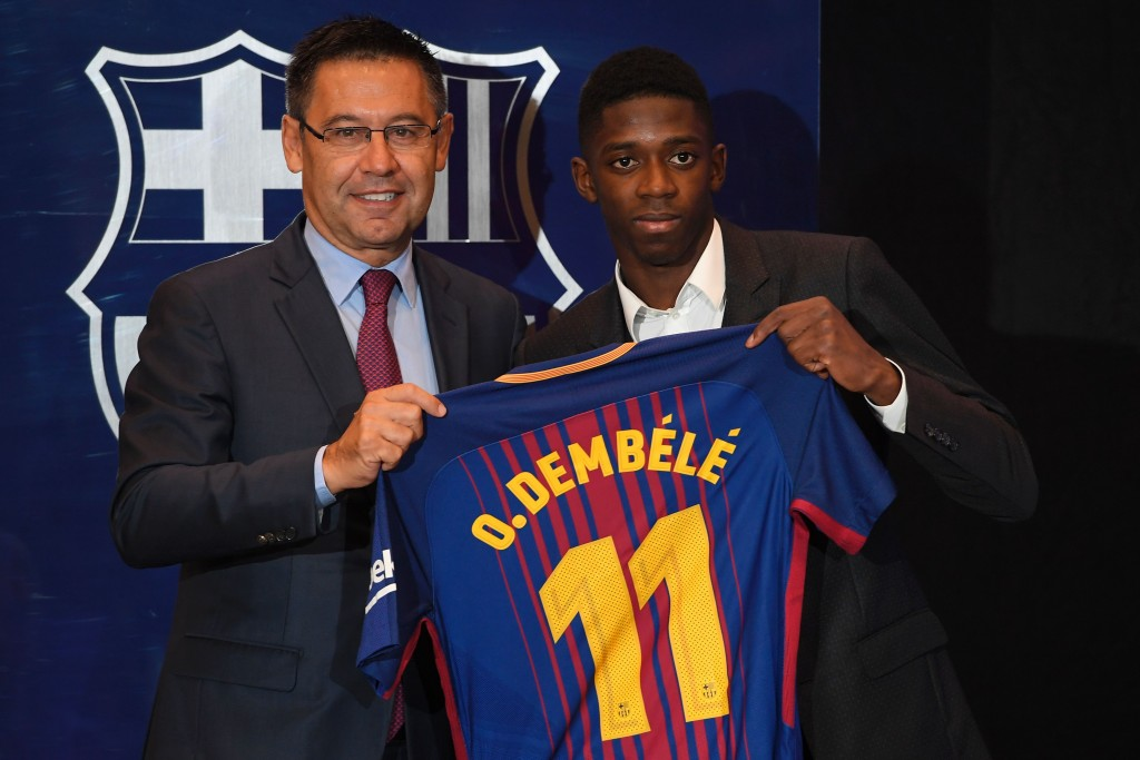 Barcelona's new player Ousmane Dembele (R) poses with his new jersey next to Barcelona's president Josep Maria Bartomeu at the Camp Nou stadium in Barcelona, during his official presentation at the Catalan football club, on August 28, 2017. French starlet Ousmane Dembele agreed a five-year deal with Barcelona worth 105 million euros ($125 million) plus add-ons. Dembele, 20, moves from Borussia Dortmund, where he has been suspended since he boycotted training on August 10 in protest after the German club rejected Barca's first bid. / AFP PHOTO / LLUIS GENE (Photo credit should read LLUIS GENE/AFP/Getty Images)