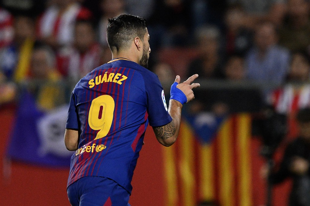 Barcelona's forward from Uruguay Luis Suarez celebrates after scoring during the Spanish league football match Girona FC vs FC Barcelona at the Montilivi stadium in Girona on September 23, 2017. / AFP PHOTO / Josep LAGO (Photo credit should read JOSEP LAGO/AFP/Getty Images)