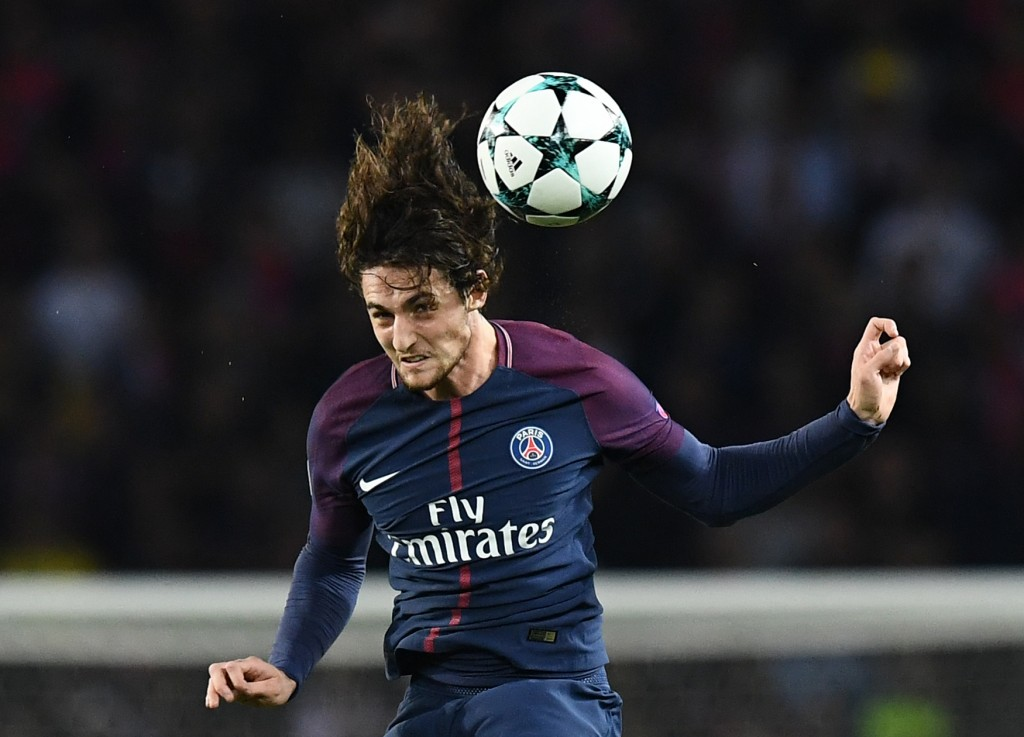 Paris Saint-Germain's French midfielder Adrien Rabiot heads the ball during the UEFA Champions League football match between Paris Saint-Germain and Bayern Munich on September 27, 2017 at the Parc des Princes stadium in Paris. / AFP PHOTO / FRANCK FIFE (Photo credit should read FRANCK FIFE/AFP/Getty Images)