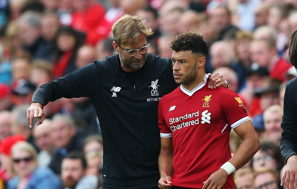 LIVERPOOL, ENGLAND - SEPTEMBER 16: Jurgen Klopp, Manager of Liverpool speaks to Alex Oxlade-Chamberlain of Liverpool before he comes on during the Premier League match between Liverpool and Burnley at Anfield on September 16, 2017 in Liverpool, England. (Photo by Alex Livesey/Getty Images)