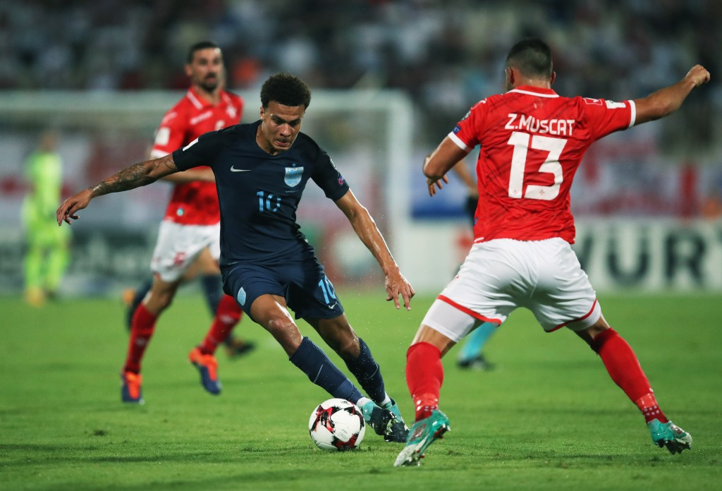 VALLETTA, MALTA - SEPTEMBER 01: Dele Alli of England is faced by Zach Muscat of Malta during the FIFA 2018 World Cup Qualifier between Malta and England at Ta'Qali National Stadium on September 1, 2017 in Valletta, Malta. (Photo by Julian Finney/Getty Images)