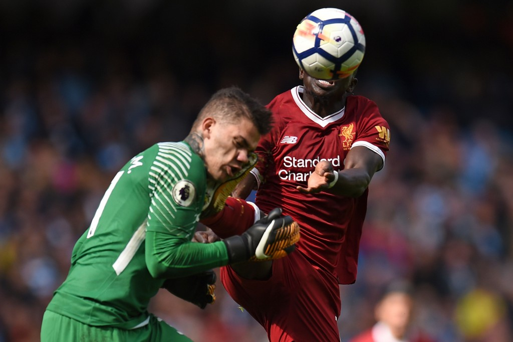 TOPSHOT - Liverpool's Senegalese midfielder Sadio Mane (R) challenges Manchester City's Brazilian goalkeeper Ederson (L), a challenge for which he is sent off, during the English Premier League football match between Manchester City and Liverpool at the Etihad Stadium in Manchester, north west England, on September 9, 2017. / AFP PHOTO / Oli SCARFF / RESTRICTED TO EDITORIAL USE. No use with unauthorized audio, video, data, fixture lists, club/league logos or 'live' services. Online in-match use limited to 75 images, no video emulation. No use in betting, games or single club/league/player publications. / (Photo credit should read OLI SCARFF/AFP/Getty Images)