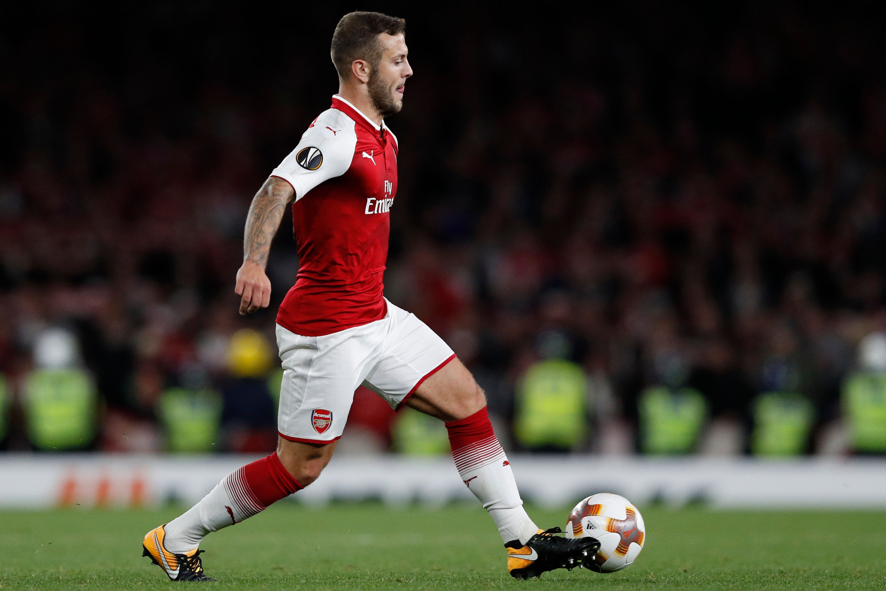 Arsenal's English midfielder Jack Wilshere runs with the ball during the UEFA Europa League Group H football match between Arsenal and FC Cologne at The Emirates Stadium in London on September 14, 2017. / AFP PHOTO / Adrian DENNIS (Photo credit should read ADRIAN DENNIS/AFP/Getty Images)
