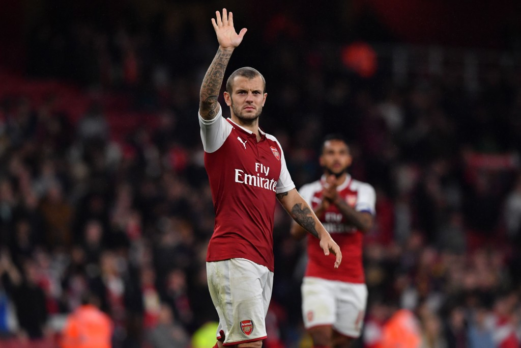Arsenal's English midfielder Jack Wilshere gestures to supporters on the pitch after the English League Cup fourth round football match between Arsenal and Norwich City at The Emirates Stadium in London on October 24, 2017. Arsenal won the game 2-1 after extra time after the game finished 1-1. / AFP PHOTO / Ben STANSALL / RESTRICTED TO EDITORIAL USE. No use with unauthorized audio, video, data, fixture lists, club/league logos or 'live' services. Online in-match use limited to 75 images, no video emulation. No use in betting, games or single club/league/player publications. / (Photo credit should read BEN STANSALL/AFP/Getty Images)