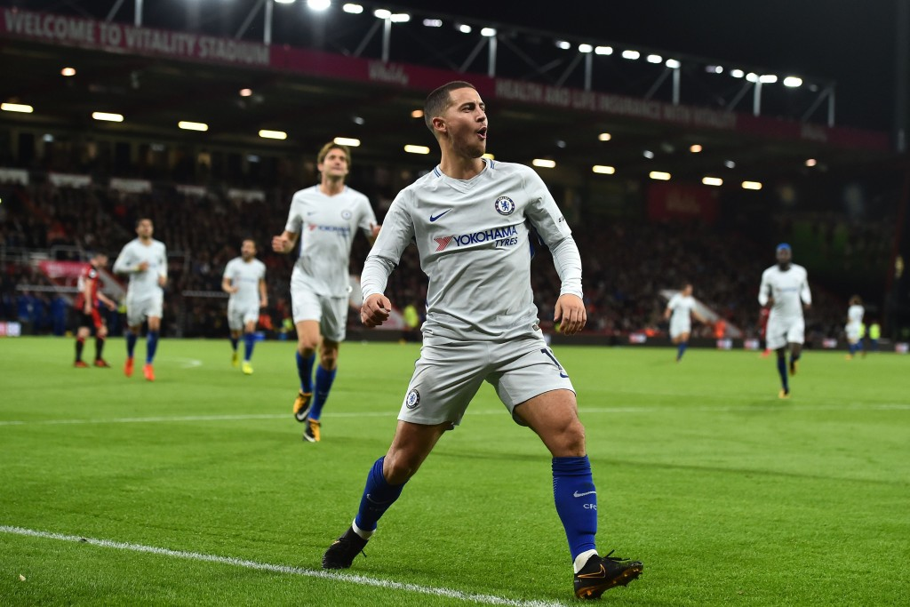 Chelsea's Belgian midfielder Eden Hazard celebrates after scoring the opening goal of the English Premier League football match between Bournemouth and Chelsea at the Vitality Stadium in Bournemouth, southern England on October 28, 2017. / AFP PHOTO / Glyn KIRK / RESTRICTED TO EDITORIAL USE. No use with unauthorized audio, video, data, fixture lists, club/league logos or 'live' services. Online in-match use limited to 75 images, no video emulation. No use in betting, games or single club/league/player publications. / (Photo credit should read GLYN KIRK/AFP/Getty Images)