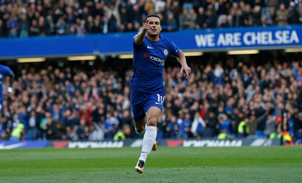 Chelsea's Spanish midfielder Pedro celebrates scoring the opening goal during the English Premier League football match between Chelsea and Watford at Stamford Bridge in London on October 21, 2017. / AFP PHOTO / Ian KINGTON / RESTRICTED TO EDITORIAL USE. No use with unauthorized audio, video, data, fixture lists, club/league logos or 'live' services. Online in-match use limited to 75 images, no video emulation. No use in betting, games or single club/league/player publications. / (Photo credit should read IAN KINGTON/AFP/Getty Images)
