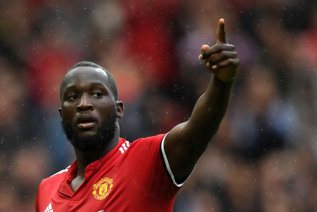 Manchester United's Belgian striker Romelu Lukaku celebrates scoring the team's fourth goal during the English Premier League football match between Manchester United and Crystal Palace at Old Trafford in Manchester, north west England, on September 30, 2017. / AFP PHOTO / Paul ELLIS / RESTRICTED TO EDITORIAL USE. No use with unauthorized audio, video, data, fixture lists, club/league logos or 'live' services. Online in-match use limited to 75 images, no video emulation. No use in betting, games or single club/league/player publications. / (Photo credit should read PAUL ELLIS/AFP/Getty Images)