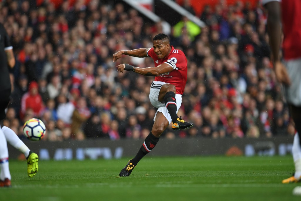 Manchester United's Ecuadorian midfielder Antonio Valencia takes a shot at goal during the English Premier League football match between Manchester United and Crystal Palace at Old Trafford in Manchester, north west England, on September 30, 2017. / AFP PHOTO / Paul ELLIS / RESTRICTED TO EDITORIAL USE. No use with unauthorized audio, video, data, fixture lists, club/league logos or 'live' services. Online in-match use limited to 75 images, no video emulation. No use in betting, games or single club/league/player publications. / (Photo credit should read PAUL ELLIS/AFP/Getty Images)