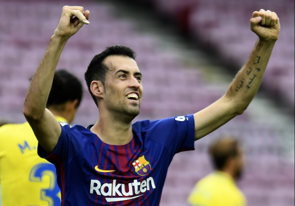 Barcelona's Spanish midfielder Sergio Busquets celebrates after scoring a goal during the Spanish league football match FC Barcelona vs UD Las Palmas played behind closed doors at the Camp Nou stadium in Barcelona on October 1, 2017. / AFP PHOTO / JOSE JORDAN (Photo credit should read JOSE JORDAN/AFP/Getty Images)
