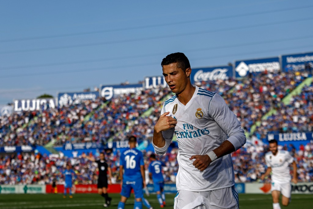 Real Madrid's Portuguese forward Cristiano Ronaldo crosses himself to celebrate his team's second goal during the Spanish league football match Getafe CF vs Real Madrid CF at the Col. Alfonso Perez stadium in Getafe on October 14, 2017. / AFP PHOTO / OSCAR DEL POZO (Photo credit should read OSCAR DEL POZO/AFP/Getty Images)