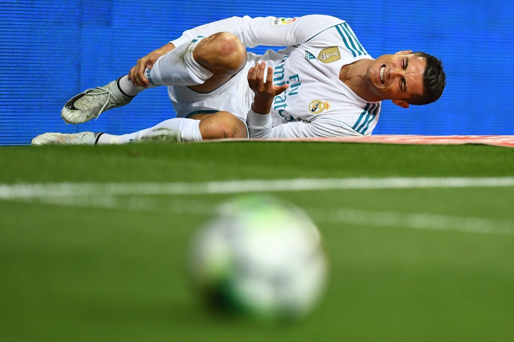 Real Madrid's Portuguese forward Cristiano Ronaldo reacts after being fouled during the Spanish league football match Real Madrid CF vs RCD Espanyol at the Santiago Bernabeu stadium in Madrid on October 1, 2017. / AFP PHOTO / GABRIEL BOUYS (Photo credit should read GABRIEL BOUYS/AFP/Getty Images)