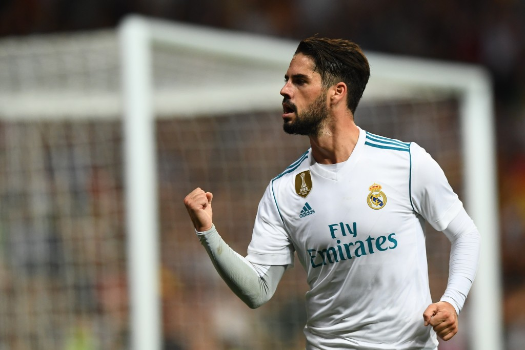 Real Madrid's midfielder Isco celebrates his second goal during the Spanish league football match Real Madrid CF vs RCD Espanyol at the Santiago Bernabeu stadium in Madrid on October 1, 2017. / AFP PHOTO / GABRIEL BOUYS (Photo credit should read GABRIEL BOUYS/AFP/Getty Images)