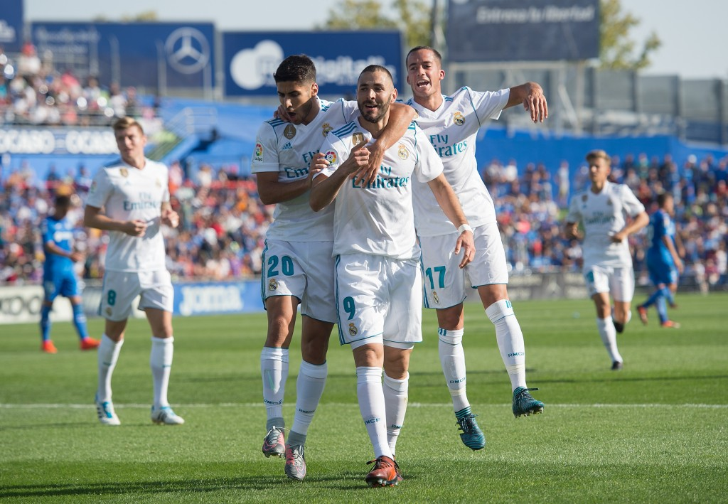 GETAFE, SPAIN - OCTOBER 14: Karim Benzema of Real Madrid CF celebrates after scoring his team's opening goal during the La Liga match between Getafe and Real Madrid at Coliseum Alfonso Perez on October 14, 2017 in Getafe, Spain. (Photo by Denis Doyle/Getty Images)