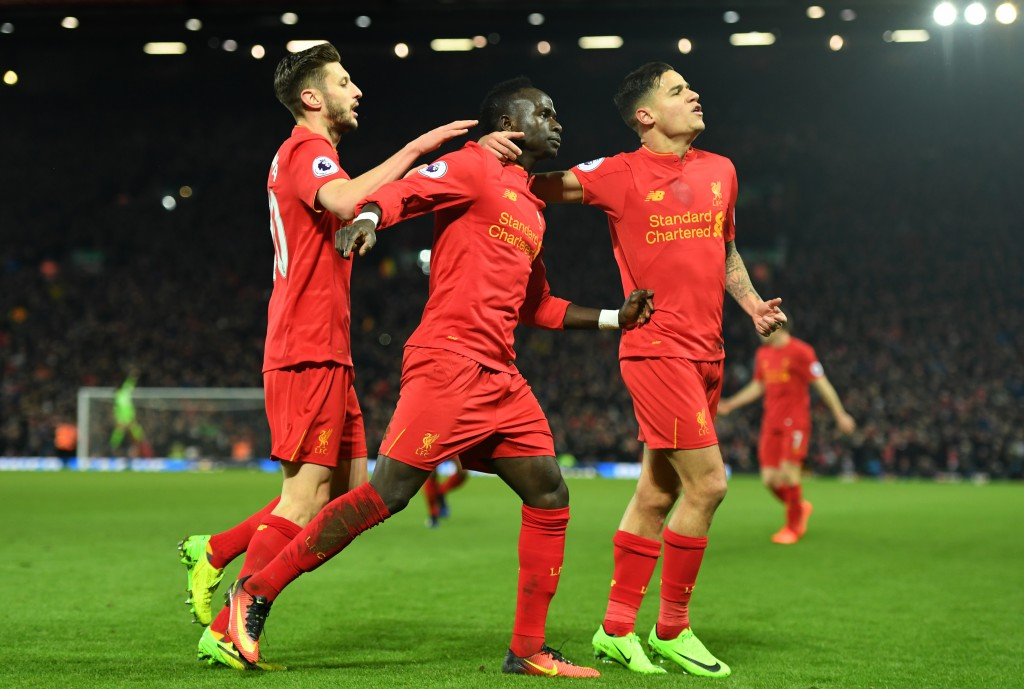 LIVERPOOL, ENGLAND - FEBRUARY 11: Sadio Mane (C) of Liverpool celebrates scoring his side's second goal with his team mate Philippe Coutinho (R) and Adam Lallana (L) during the Premier League match between Liverpool and Tottenham Hotspur at Anfield on February 11, 2017 in Liverpool, England. (Photo by Mike Hewitt/Getty Images for Tottenham Hotspur FC)